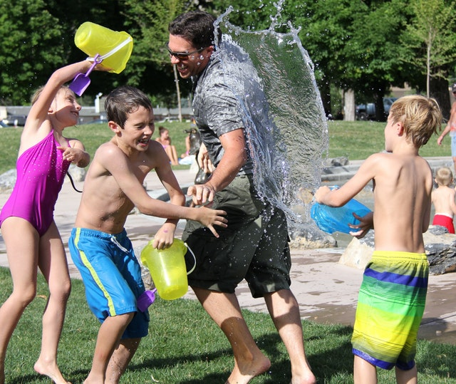 Kids playing in the water in the park - one idea for summer activities in Arizona