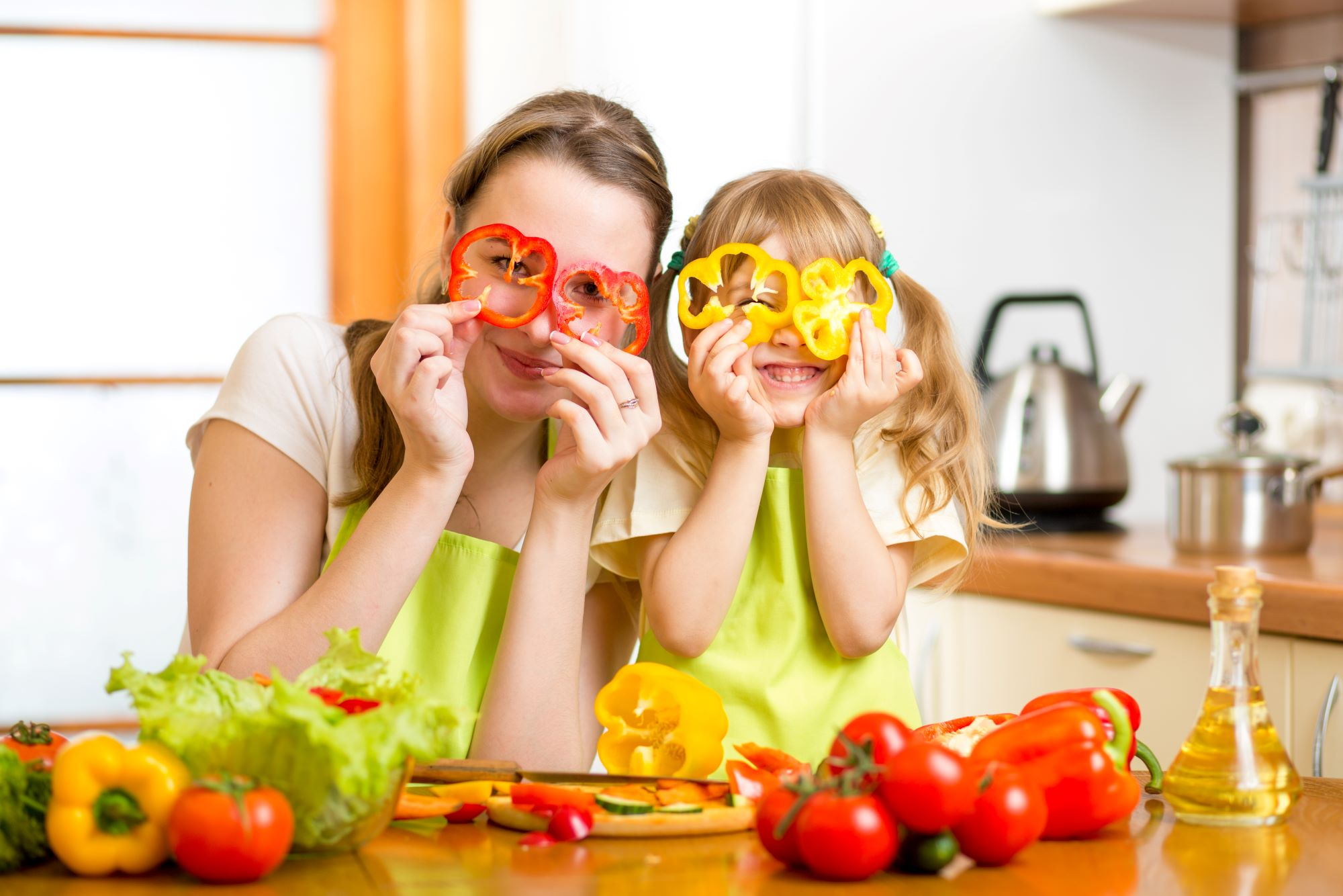 Mom and daughter with pepper slices over their eyes
